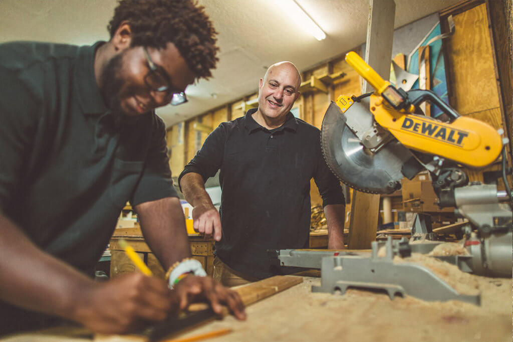 Two men working with power tools