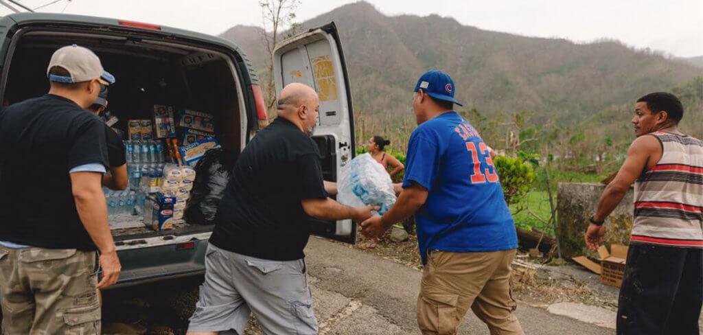 Volunteers distributing disaster relief supplies