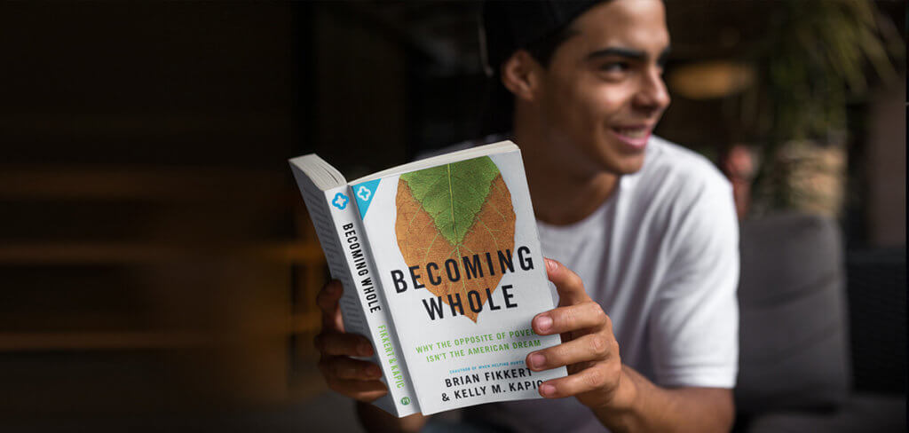 Man reading Becoming Whole