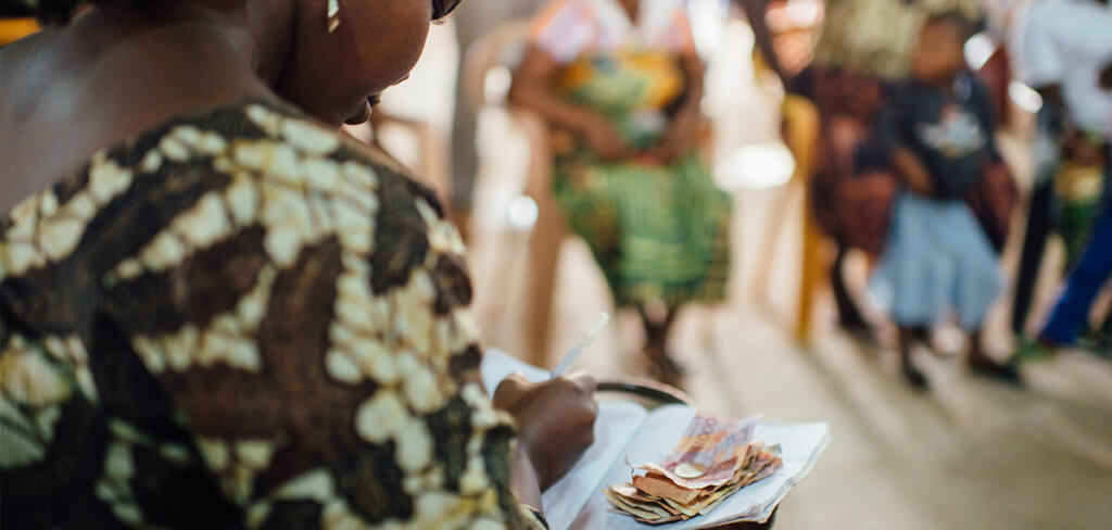 Woman in a savings group counting money