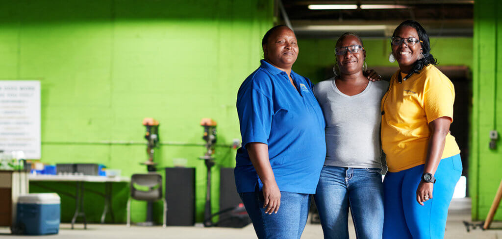 Women working in a warehouse setting