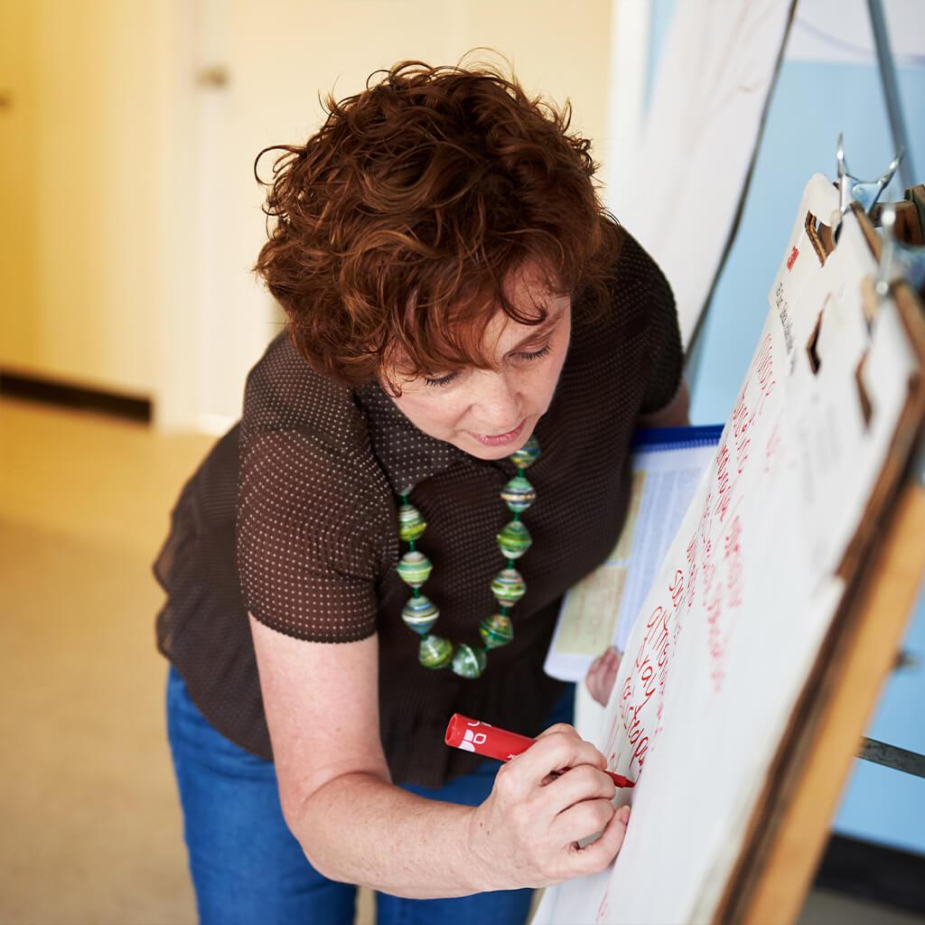 Woman writing on a flipchart