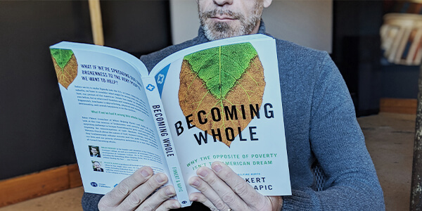 Man reading Becoming Whole book